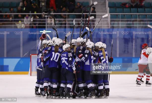 Team United States celebrates defeating Team Olympic Athletes from Russia 50 in the Women's Ice Hockey Preliminary Round Group A game on day four of...