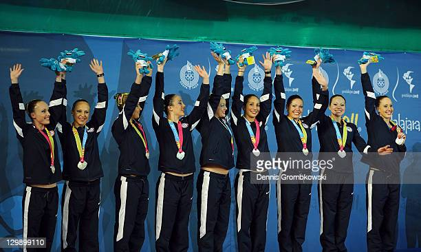 Team United States celebrates on the podium after winning the silver medal in the women's synchronized swimming free routine final during Day Seven...