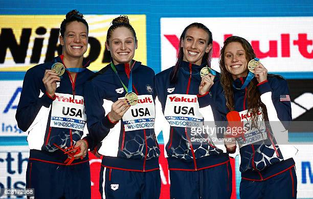 Team United States celebrates with their gold medals after their victory the woman 4x100 Freestyle final on day one of the 13th FINA World Swimming...