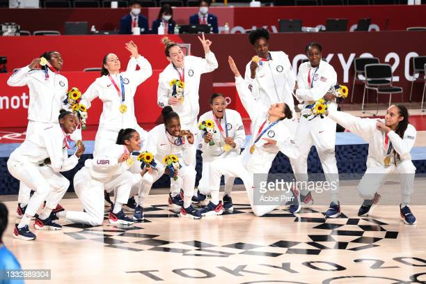 Team United States celebrates with their medals after defeating Team Japan 90-75 during the women's gold medal match between Team United States and...
