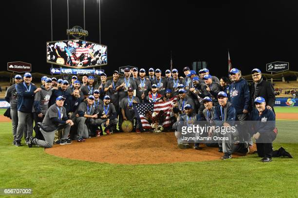 Team United States gather for a team photo with their medals and trophies after their 80 win over Puerto Rico during Game 3 of the Championship Round...