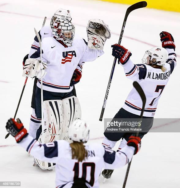TORONTO ON DECEMBER 30 Team United States goalie Molly Schaus celebrates with teammates Monique Lamoureux Meghan Duggan and Anne Schelper after...