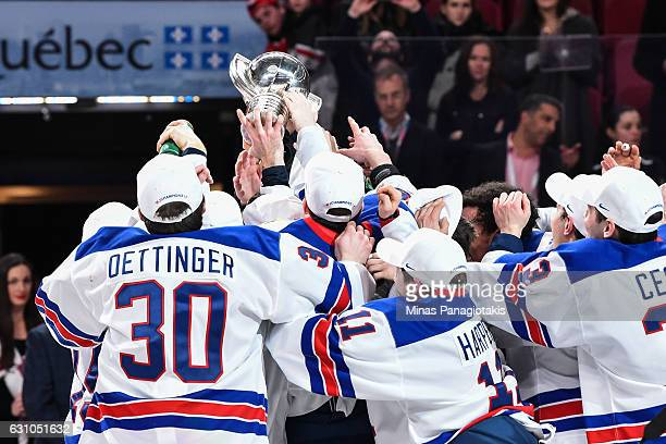Team United States hoists the IIHF trophy during the 2017 IIHF World Junior Championship gold medal game against Team Canada at the Bell Centre on...