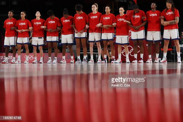 Team United States of America stands for the National Anthem before the start of a Women's Basketball Semifinals game between Team United States and...
