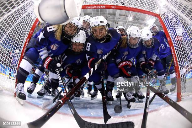 Team United States players pose in the goal prior to the Women's Gold Medal Game against Canada on day thirteen of the PyeongChang 2018 Winter...