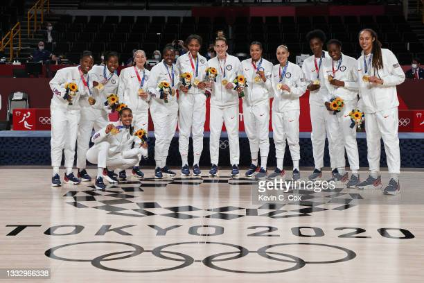 Team United States pose for photographs with their gold medals during the Women's Basketball medal ceremony on day sixteen of the 2020 Tokyo Olympic...