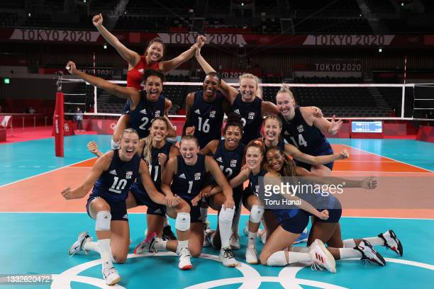 Team United States poses after defeating Team Serbia during the Women's Semifinals on day fourteen of the Tokyo 2020 Olympic Games at Ariake Arena on...