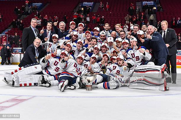 Team United States poses for a team photo after defeating Team Canada and winning the gold medal round during the 2017 IIHF World Junior Championship...