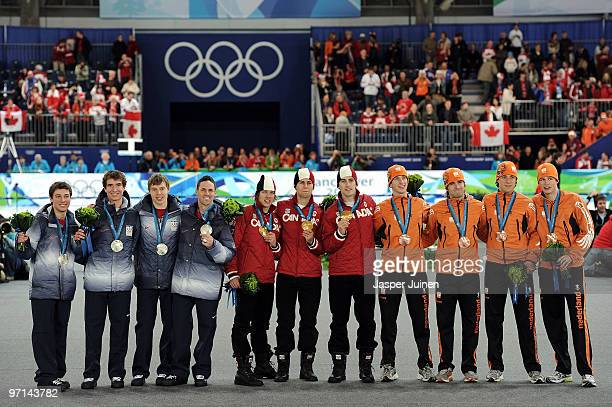 Team United States receive the silver medal Team Canada receive the gold medal and Team Netherlands receive the bronze medal during the medal...