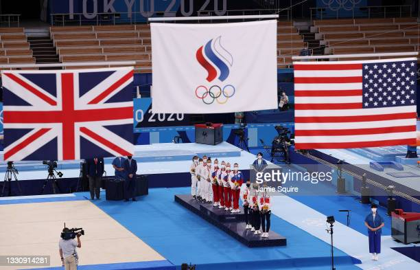 Team United States, Team ROC, and Team Great Britain watch as flags are raised during the medal ceremony after the Women's Team Final on day four of...