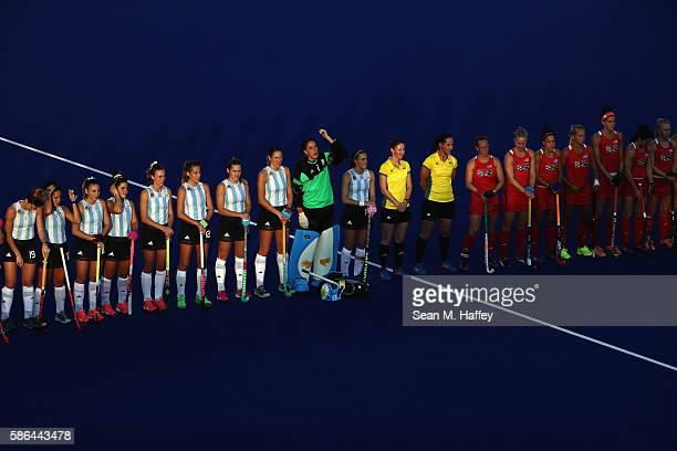 Team USA and Team Argentina line up prior to a Women's Pool B match between the United States and Argentina on Day 1 of the Rio 2016 Olympic Games at...