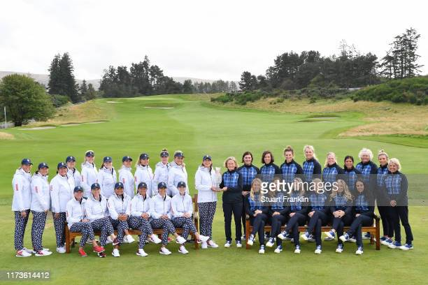 Team USA and Team Europe pose with The Solheim Cup Trophy during the official photo call during Preview Day 2 of The Solheim Cup at Gleneagles on...