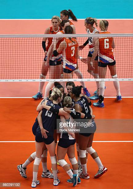 Team USA and Team Netherlands huddle during the Women's Bronze Medal Match between Netherlands and the United States on Day 15 of the Rio 2016...