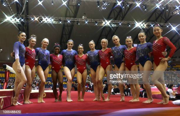 Team USA and Team Russia pose for a photograph after the Women's team final during day six of the 2018 FIG Artistic Gymnastics Championships at...