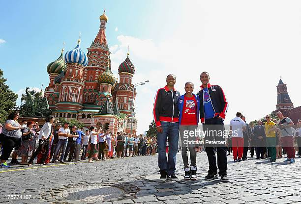 Team USA athletes Aries Merritt Allyson Felix and Ashton Eaton pose together outside of St Basil's Cathedral ahead of the 14th IAAF World...