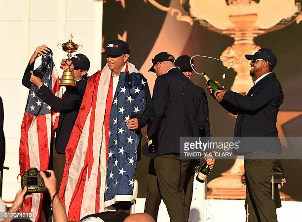 Team USA Captain Davis Love III and Vice Captain Tiger Woods celebrate during the trophy ceremony after the Singles Matches during the 41st Ryder Cup...
