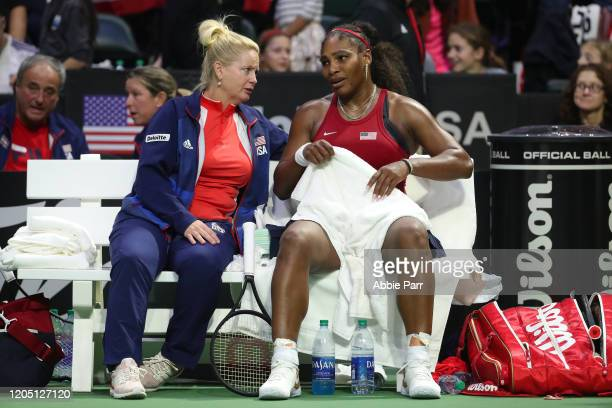 Team USA Captain Kathy Rinaldi and Serena Williams of USA react while competing against Anastasija Sevastova of Latvia during the 2020 Fed Cup...