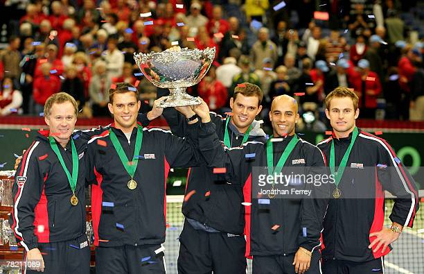 Team USA Captain Patrick McEnroe Mike Bryan Bob Bryan James Blake and Andy Roddick hoist the Davis Cup trophy after defeating Russia 41 during the...