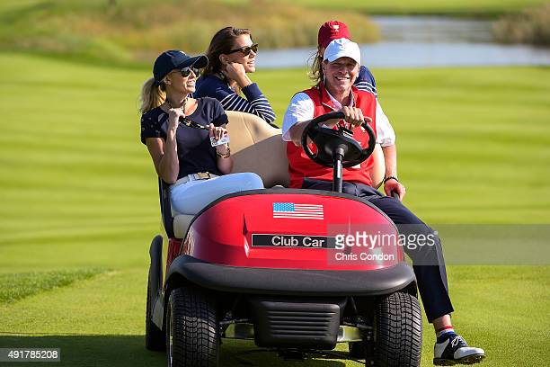 Team USA Captain's Assistant Steve Stricker drives Paulina Gretzky left and Annie Verret during the first round of The Presidents Cup at Jack...