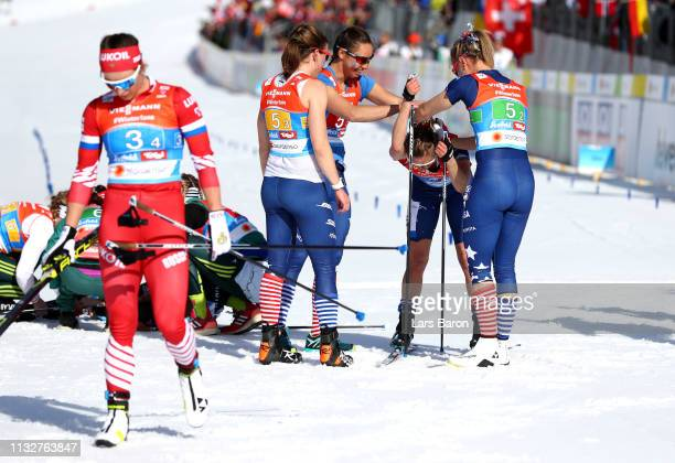 Team USA celebrate as they cross the line during the Women's Cross Country Relay at the FIS Nordic World Ski Championships on February 28 2019 in...