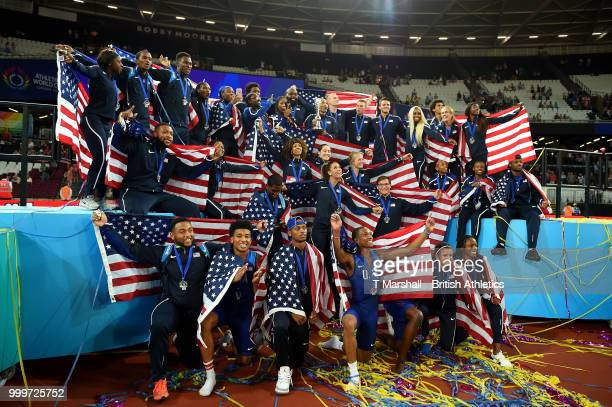 Team USA celebrate as they lift the platinum trophy during day two of the Athletics World Cup London at the London Stadium on July 15, 2018 in...