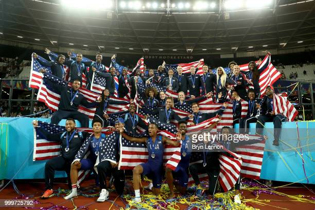 Team USA celebrate as they lift the platinum trophy during day two of the Athletics World Cup London at the London Stadium on July 15 2018 in London...
