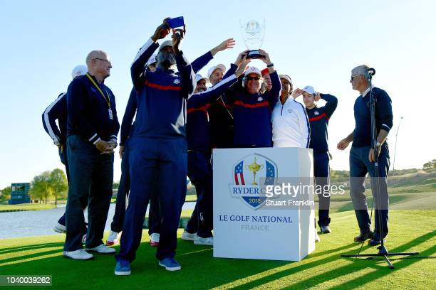 Team USA celebrate victory with the trophy after the celebrity challenge match ahead of the 2018 Ryder Cup at Le Golf National on September 25 2018...