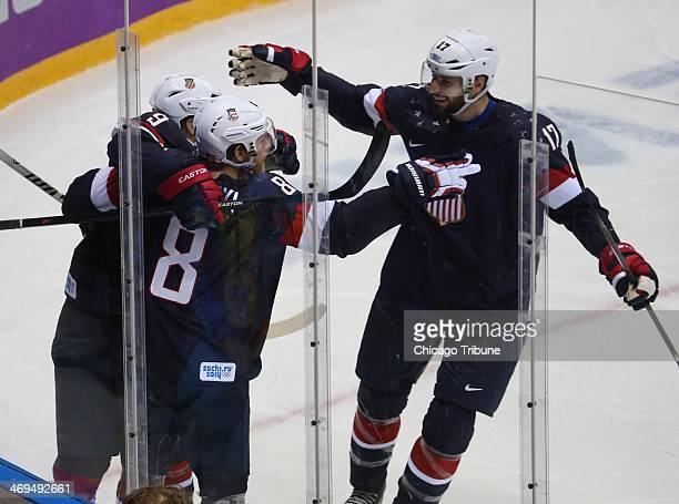 Team USA celebrates a goal by forward Joe Pavelski in the third period of a men's hockey game at Bolshoy Ice Dome during the Winter Olympics in Sochi...