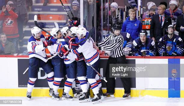 Team USA celebrates a third period goal against Finland during the gold medal game at the IIHF World Junior Championships at Rogers Arena on January...
