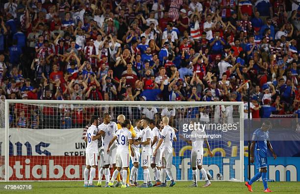 Team USA celebrates after beating Honduras 21 during the 2015 CONCACAF Gold Cup Group A match between USA and Honduras at Toyota Stadium on July 7...