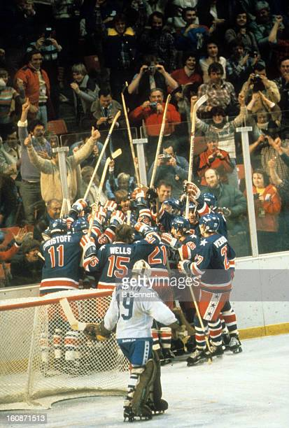 Team USA celebrates after Rob McClanahan scored the go ahead goal during the Gold Medal Game against Finland on February 24 1980 at the Olympic...