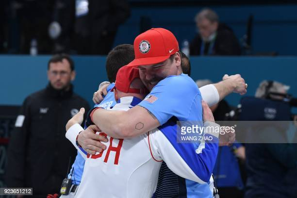 TOPSHOT Team USA celebrates after winning the curling men's gold medal game between the USA and Sweden during the Pyeongchang 2018 Winter Olympic...