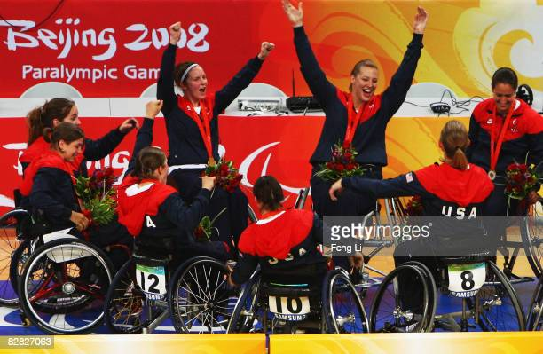 Team USA celebrates after winning the Gold after their Wheelchair Basketball match against Germany at the National Indoor Stadium during day eight of...