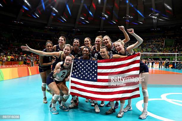 Team USA celebrates after winning the Women's Bronze Medal Match between Netherlands and the United States on Day 15 of the Rio 2016 Olympic Games at...