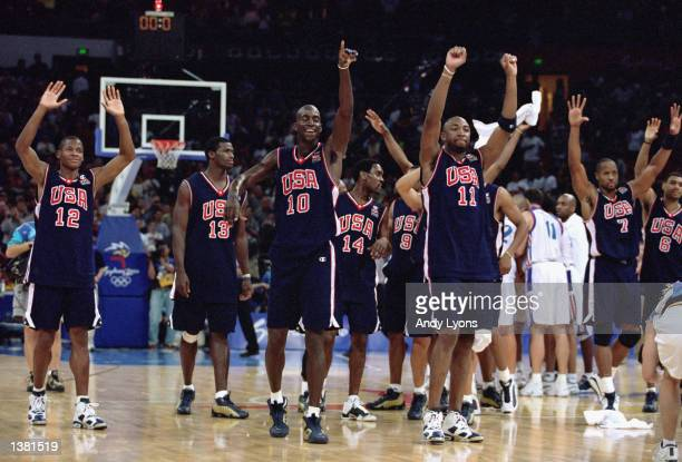 Team USA celebrates the win during the men's basketball gold medal game against France at the Sydney SuperDome during the Sydney Olympic Games in...