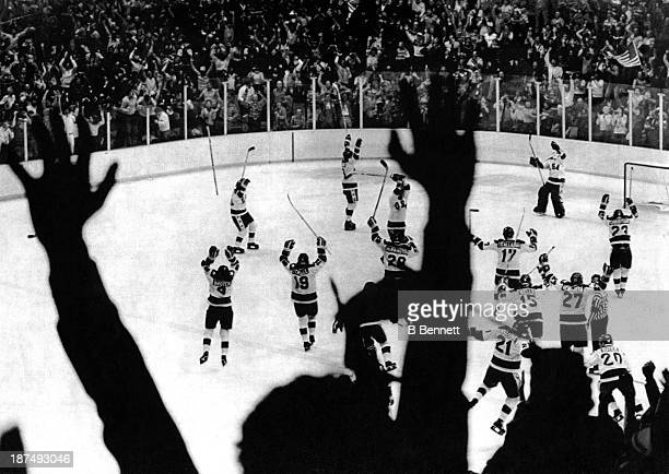 Team USA celebrates their 4-3 victory over the Soviet Union in the semi-final Men's Ice Hockey event at the 1980 Winter Olympic Games in Lake Placid,...