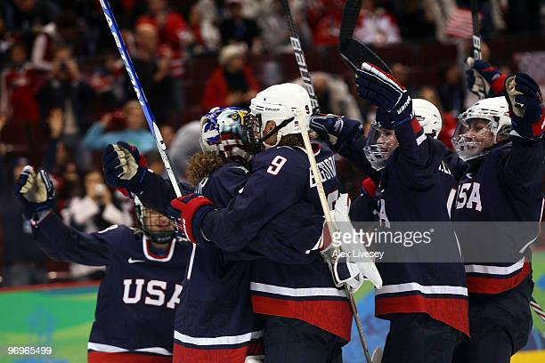 Team USA celebrates their 81 victory against Sweden during the ice hockey women's semifinal game on day 11 of the Vancouver 2010 Winter Olympics at...