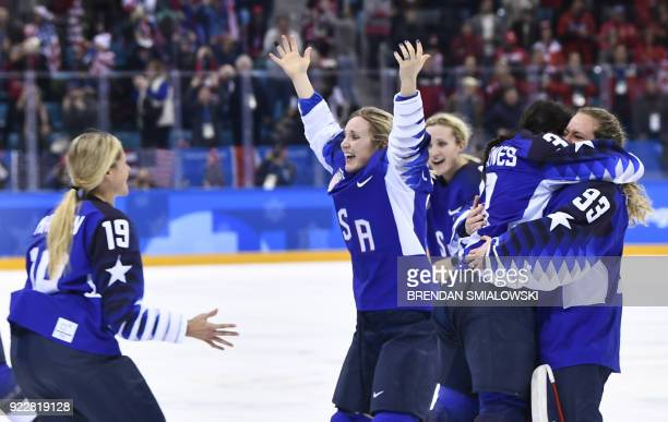 TOPSHOT Team USA celebrates winning after a penalty shootout in the women's gold medal ice hockey match between Canada and the US during the...