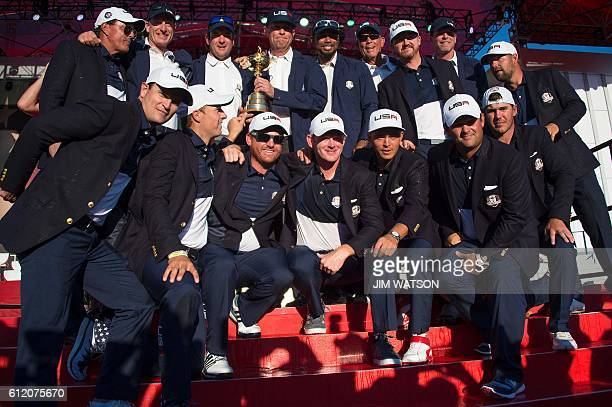 TOPSHOT Team USA celebrates winning the 41st Ryder Cup at Hazeltine National Golf Course in Chaska Minnesota October 2 2016 / AFP / JIM WATSON