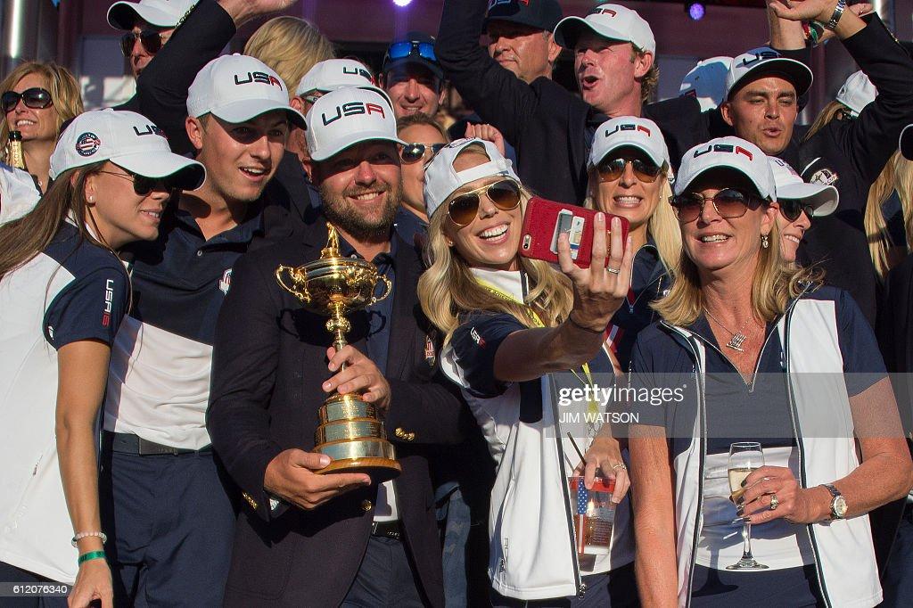 TOPSHOT - Team USA celebrates winning the 41st Ryder Cup at Hazeltine National Golf Course in Chaska, Minnesota, October 2, 2016. / AFP / JIM