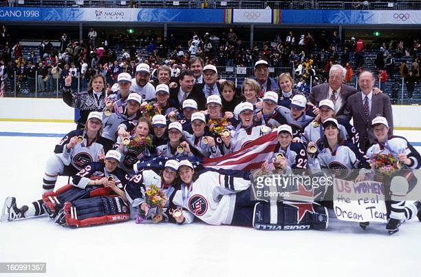 Team USA celebrates with their gold medals after the women's gold medal match against Team Canada at the 1998 Nagano Winter Olympics on February 17,...