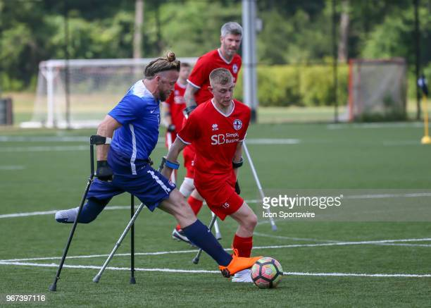 Team USA Craig Till and Team England Ben Houghton fight for ball during the Lone Star Invitational Amputee Soccer tournament on June 2 2018 at...