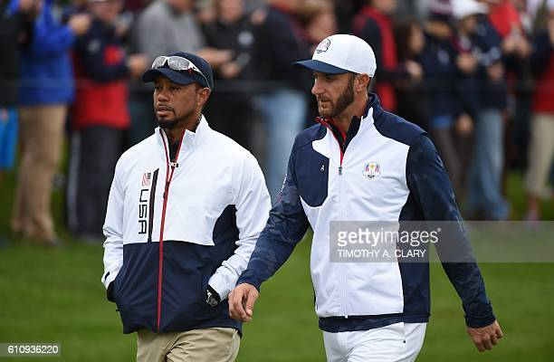 Team USA Dustin Johnson and vicecaptain Tiger Woods walk during a practice round ahead of the 41st Ryder Cup at Hazeltine National Golf Course in...