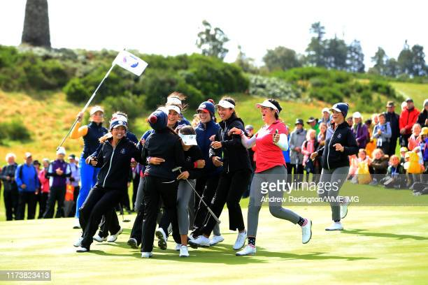 Team USA embrace Alexa Pano at the end of the match during the PING Junior Solheim Cup during Preview Day 3 of The Solheim Cup at Gleneagles on...