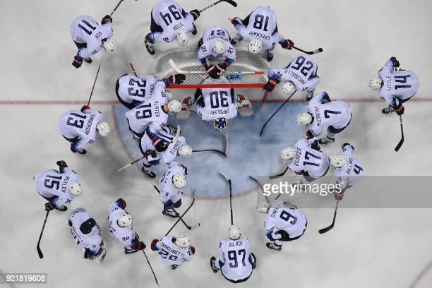 Team USA gathers at the start of the men's quarter-final ice hockey match between Czech Republic and the USA during the Pyeongchang 2018 Winter...