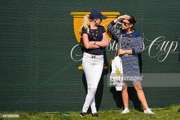 Team USA girlfriends Paulina Gretzky left and Annie Verret speak during the first round of The Presidents Cup at Jack Nicklaus Golf Club Korea on...