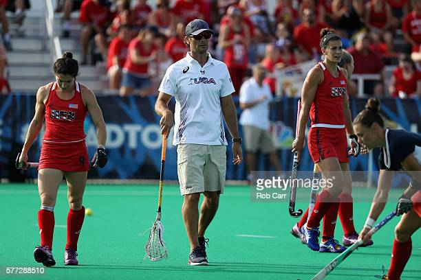 Team USA head coach Craig Parnham watches warm ups before the start their field hockey match against Team India in preparation for the upcoming Rio...