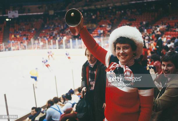 Team USA hockey fan rings a bell in the stands during the Winter Olympics featuring the United States and the Soviet Union on February 22 1980 in...