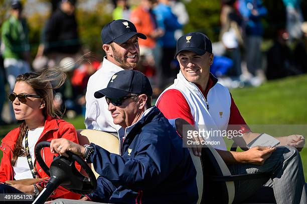 Team USA Jordan Spieth Dustin Johnson Captain's Assistant Davis Love III and Annie Verret ride in a cart during the second round of The Presidents...