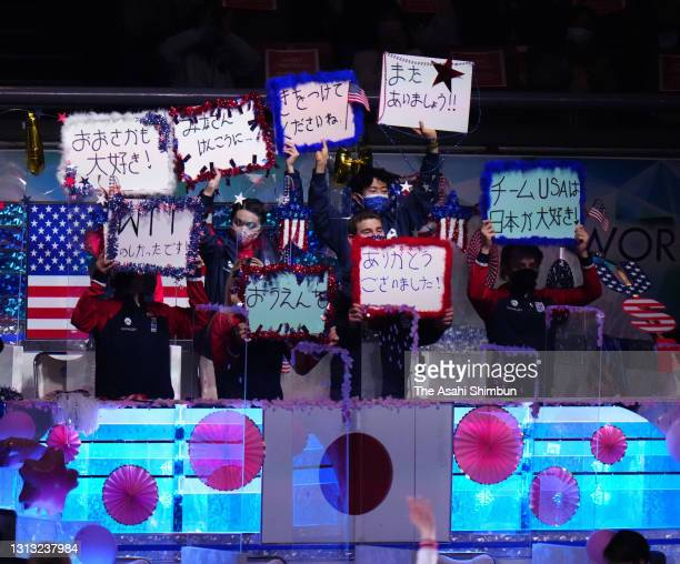 Team USA members hold messages to thank fans during the gala exhibition of the ISU World Team Trophy at Maruzen Intec Arena Osaka on April 18, 2021...